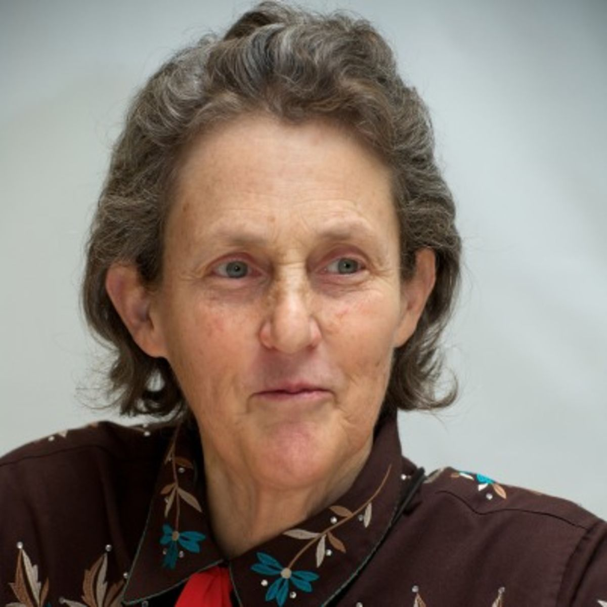 an analysis of a young womans struggle with autism in temple grandin by mike jackson