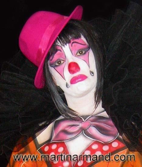 Sad female clown painting