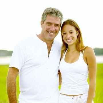Middle aged man younger woman