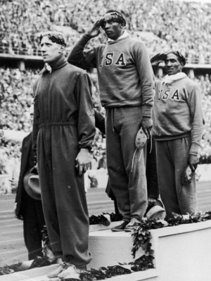 Jesse Owens stands on the podium after winning the gold medal in the ...