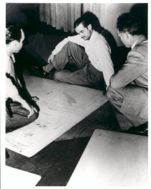 Photograph of Howard Hughes and others studying Flying Boat plans ...