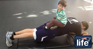 Too cute: Tom Brady continues hard work with his 'little trainer'