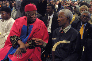 Chinua Achebe (left) at the University of Cape Town in 2002, with ...