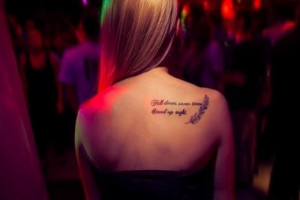 Fall down seven times stand up eight quote tattoo on back