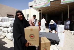 Iraqis displaced by ISIS collect Red Cross aid. Haidar Hamdani/AFP ...