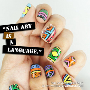 Nail art used in photo is Tribal .