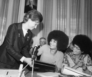 leader of the Soviet Women's Committee (left) hands a memento to ...