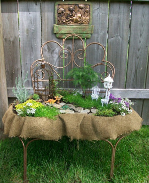 fairy garden out of an old metal chair