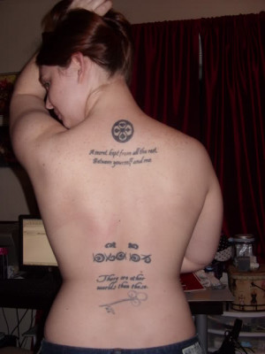 On the top of my back, I have a quote from Alice in Wonderland: