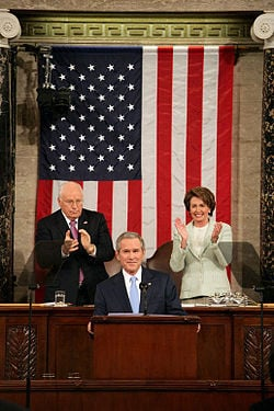 ... Vice President Dick Cheney and House Speaker Nancy Pelosi behind him