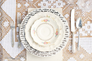 plates with handwritten quotes from literature written in permanent ...