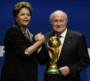 fifa president sepp blatter stands next to the world cup trophy as he ...