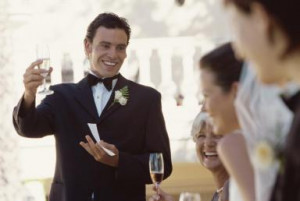 Best man making a toast on the head table at a wedding reception ...