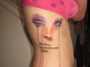 eyes weep blue tears in this quote tattoo about being all alone in ...