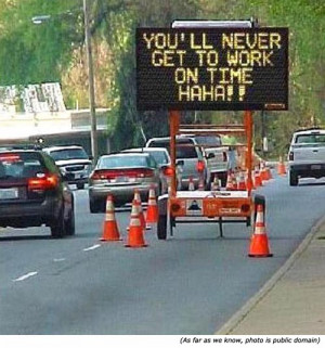 Funny road work sign: You'll never get to work on time, ha ha!