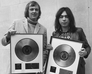 With Tim Rice again, displaying the gold and platinum discs awarded ...