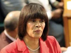 ... premier portia simpson miller is vastbesloten haar plannen door te