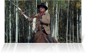 Photo of John Wayne, who portrays Marshall Reuben J. 'Rooster' Cogburn ...