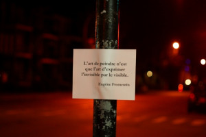 Paper with quotation on a traffic light post on St. Denis St.