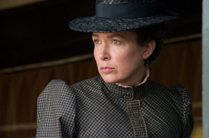 Elizabeth Marvel as 40-year-old Mattie Ross