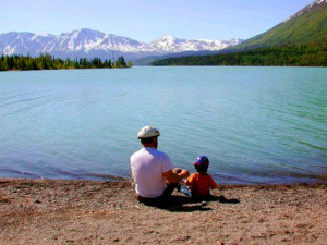 fathers-day-father-with-kid-on-lake.jpg