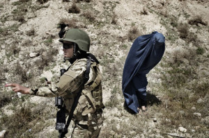 During a training exercise, a female special-forces member prepares to ...