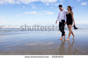 Walking+hand+in+hand+on+the+beach
