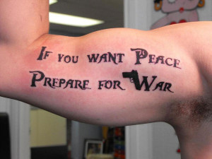 Carved in bold capital letters, this tattoo with a gun shape hidden in ...