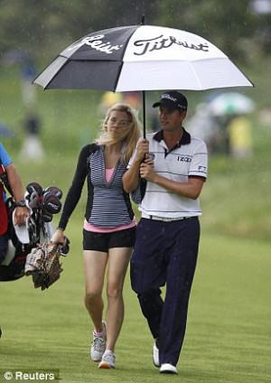Defending champion: Webb Simpson, with his wife Dowd, has made a ...