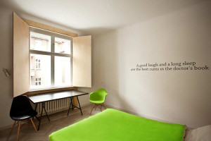 polish apt bedroom with quote on wall