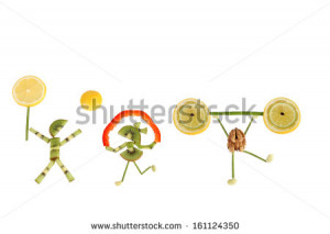 Healthy eating. Funny little people of the kiwi slices. - stock photo