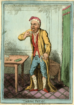 man in a dressing gwon and cap pulls a face, as he lifts a glass of ...