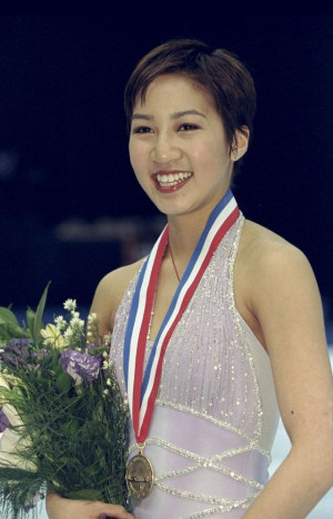Michelle Kwan poses with her gold medal at the U.S. Figure Skating ...