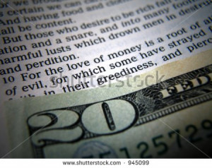 Bible verse about money next to cash - stock photo