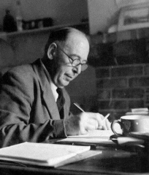 Lewis writing in his study.