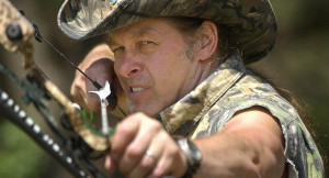 Ted Nugent takes aim with a hunting bow for a photo on his ranch near ...