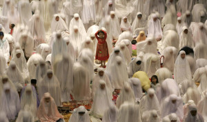Muslim women attend prayers on the eve of the first day of the Islamic ...