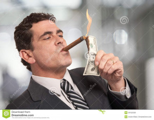 Rich businessman lighting cigar with $100 dollar bill.