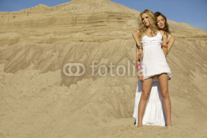 Photo: Two girls friends - blond and brunette