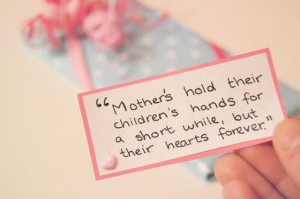 Mothers hold their childrens hands for a short