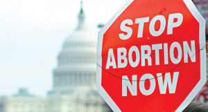 sign reading 'Stop abortion now' is pictured in front of the Capitol ...