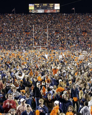 Auburn fans storm the field after their 34-28 after a win over top ...