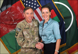 ... shows Gen. Davis Petraeus, left, shaking hands with Paula Broadwell