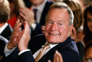 Image: Former President George H. W. Bush applauds during an event to ...