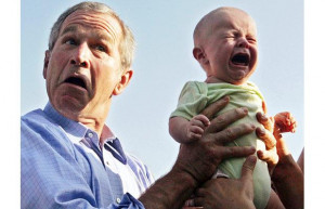 George W. Bush hands back a crying baby that was handed to him from ...