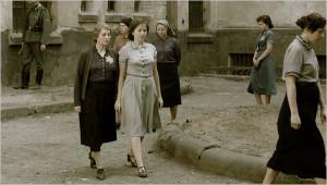 In an reenactment, Meri Roth, right, as Hannah Senesh, & Marcela ...
