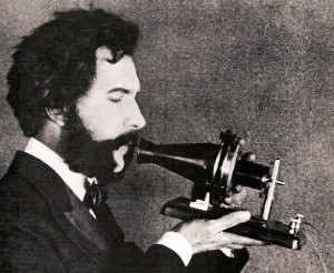 Bell Speaking into Telephone (1876)