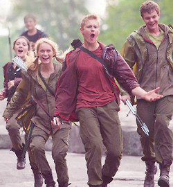 The Careers taunt Katniss as they chase her.