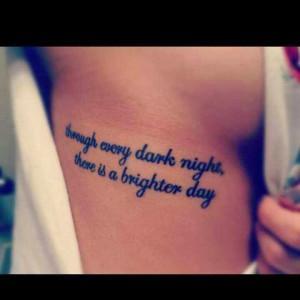 Quote tattoos on rib