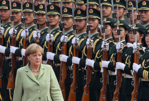 Germany's Chancellor Angela Merkel reviews an honour guard during a ...